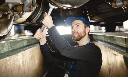 Man in uniform. Truck repair. Car malfunction